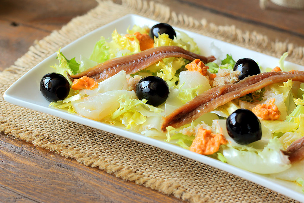 Cod, anchovies, and black olives salad